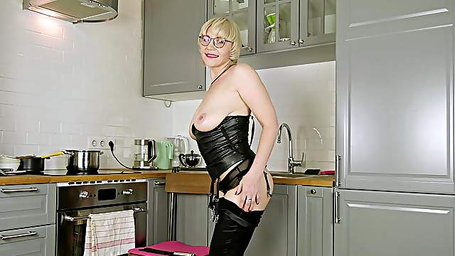 Bespectacled busty broad Nika masturbates in her kitchen